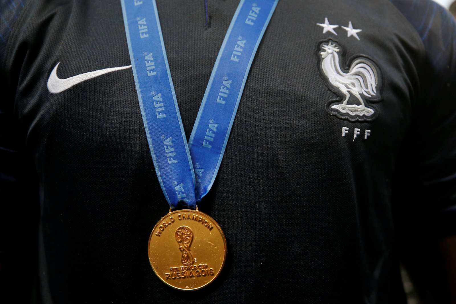 World Cup winner's medal on the chest of a France player