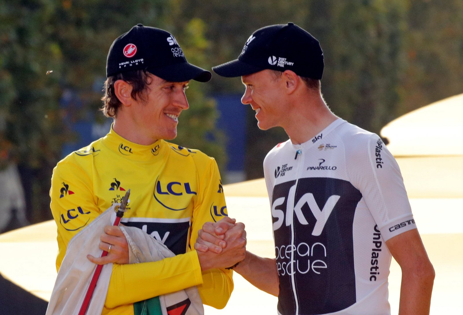 Geraint Thomas and Chris Froome celebrate winning 2018 Tour de France