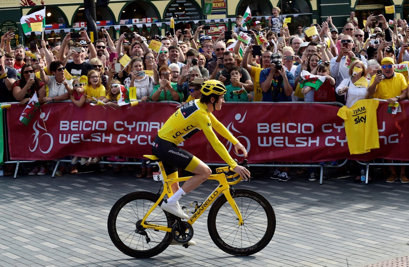 Geraint Thomas rides past Welsh fans after winning 2018 Tour de France