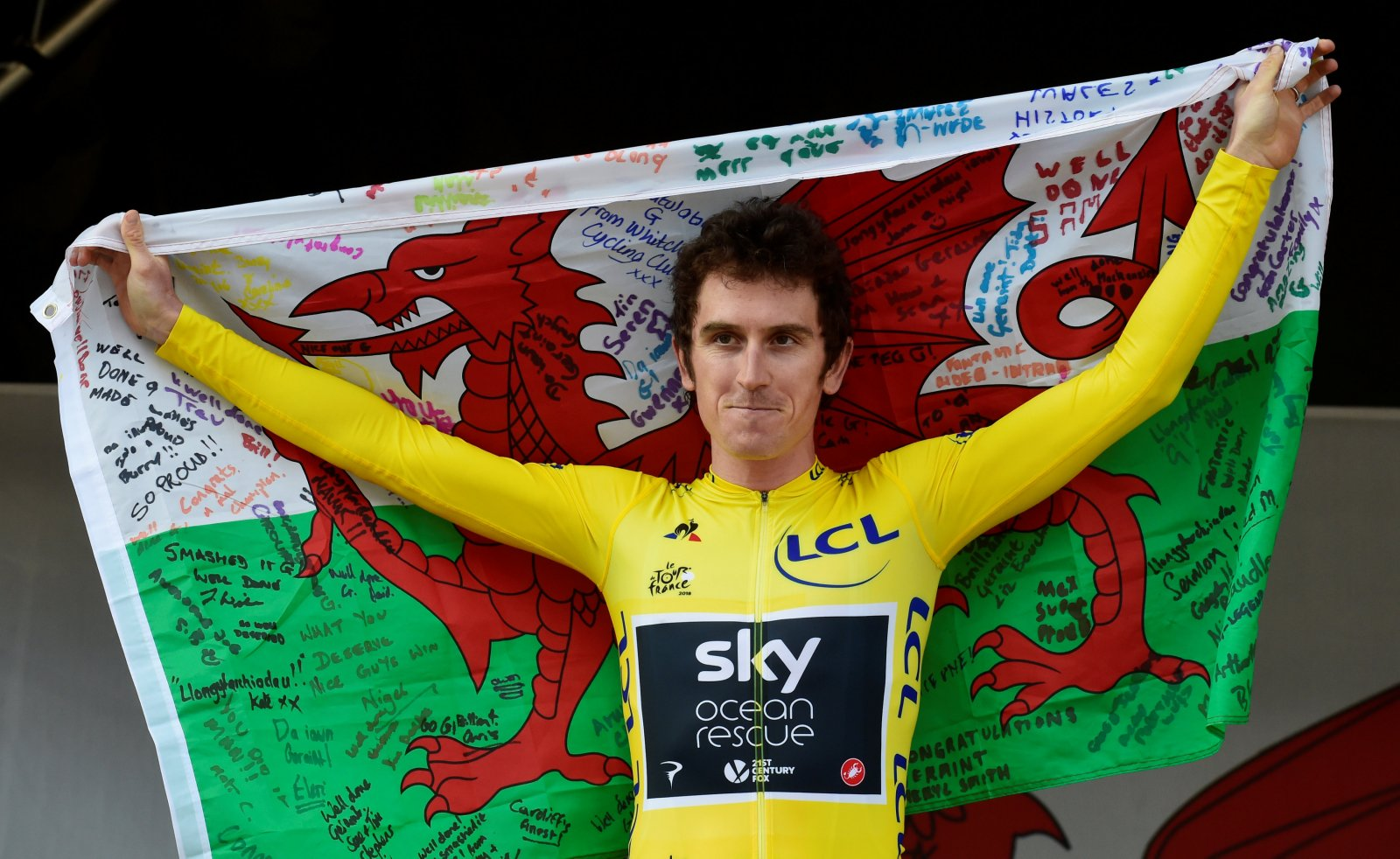 Geraint Thomas celebrates winning the Tour de France 2018