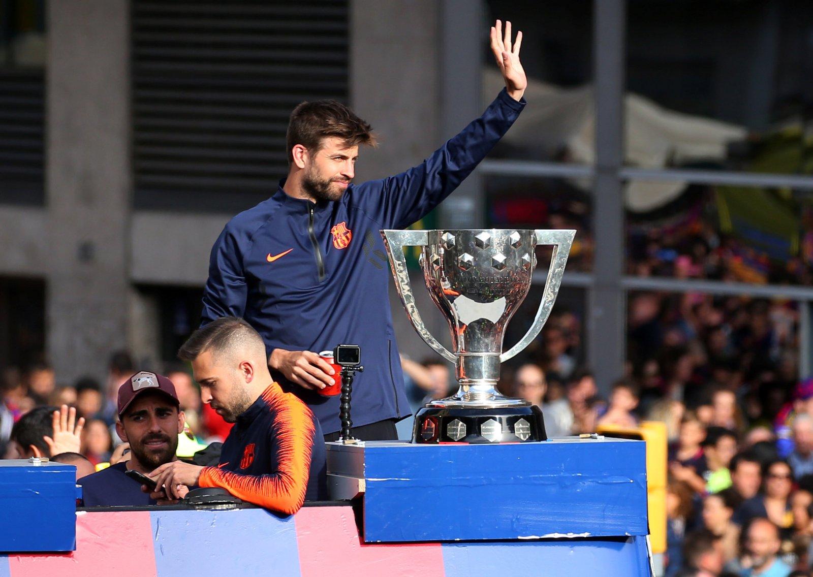 Gerard Pique with the La Liga trophy